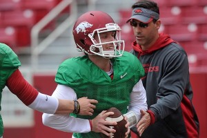PHOTO BY MICHAEL WOODS Arkansas quarterback Austin Allen works with offensive coordinator Dan Enos during practice Saturday, April 11, 2015, at Donald W. Reynolds Razorback Stadium in Fayetteville.